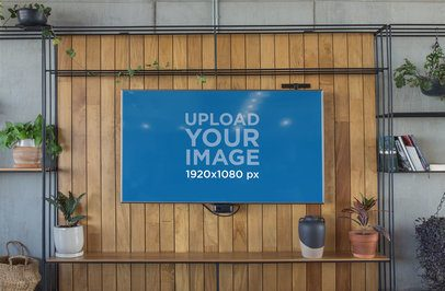 Mockup of a Smart TV on a Wall with Plants 25812