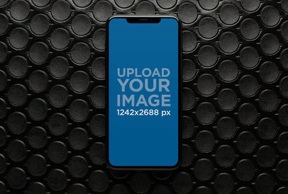 Mockup of an iPhone XS Max over a Patterned Surface 25963