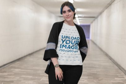 Mockup of a Girl Wearing a Plus Size Tee in a Long Urban Hallway 25485
