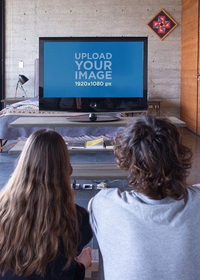 Mockup of Two Friends Watching Tv Together 25843