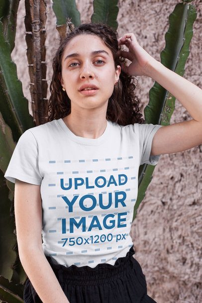 Tee Mockup of a Curly-Haired Girl Sitting by a Cactus 25794