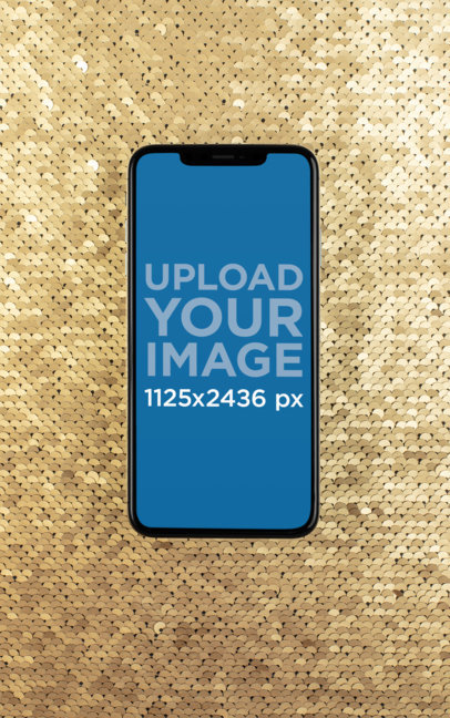iPhone XS Mockup over a Golden Sequin Surface 25967