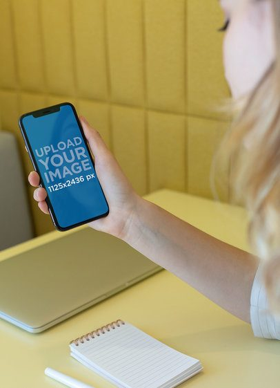 Mockup of a Blonde Girl Using Her iPhone XS 25435