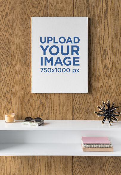 Vertical Canvas Print Mockup Hanging in a Room with Minimalist Furniture 25859
