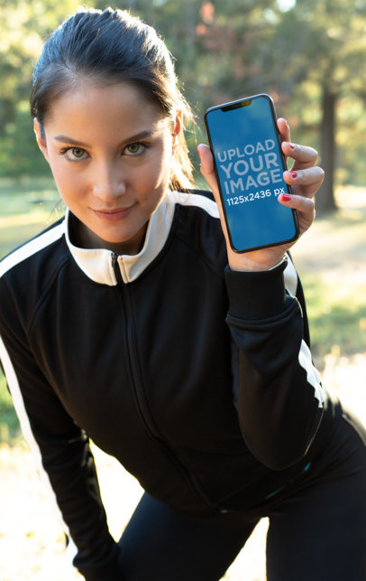 iPhone XS Mockup of a Woman Wearing Active Wear 25977