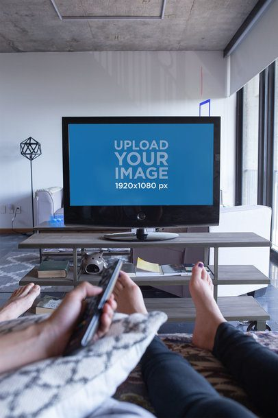Smart Tv Mockup Featuring a Barefoot Couple in a Modern Living Room 25846