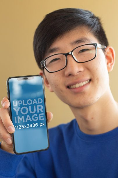 iPhone X Mockup of a Smiling Man with Glasses 25542
