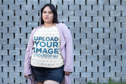 Plus Size T-Shirt Mockup of a Woman in a Short Skirt by a Concrete-Tiles Wall 25460