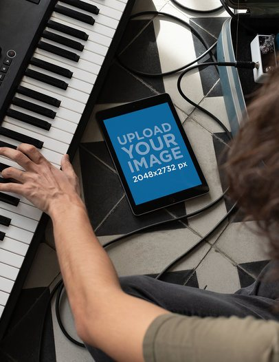 iPad Mockup of a Man Playing a Keyboard 25749