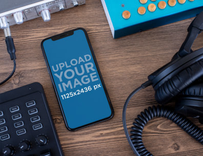 iPhone X Mockup Surrounded by Audio Devices 25611