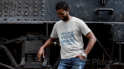 T-Shirt Video of a Man Posing Next to a Locomotive 12780