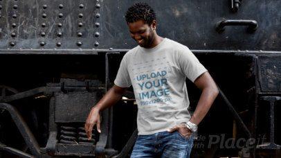 T-Shirt Video of a Man Posing Next to a Locomotive 12780