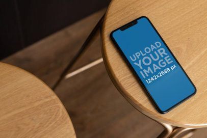 iPhone XS Max Mockup over a Simple Wooden Stool 25890