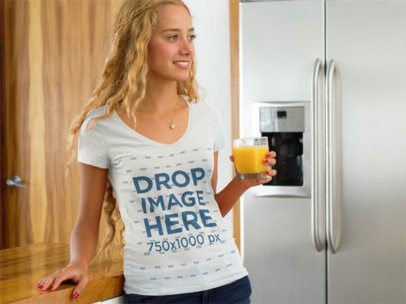 T-Shirt Mockup of a Woman Having a Glass of Orange Juice a7793