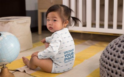 Onesie Mockup Featuring a Baby Girl by a Crib 25136
