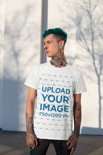 T-Shirt Mockup of a Pierced Man with Tattoos Looking Away 26478