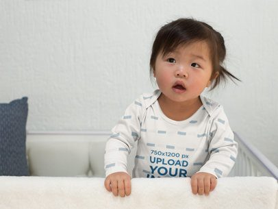 Onesie Mockup of a Baby Girl Leaning out of Her Crib 25134