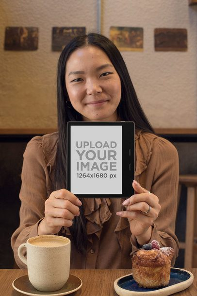 Mockup of a Pretty Girl Holding a Kindle in a Cafe 26023