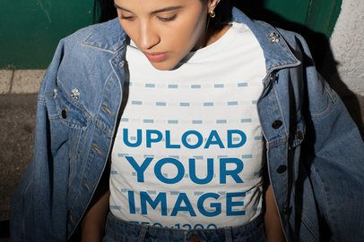 Tee Mockup of a Young Woman with a Denim Jacket over Her Shoulders 26546
