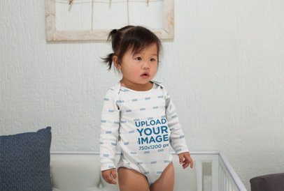 Sublimated Onesie Mockup of a Cute Baby Girl Standing Inside Her Crib 25132