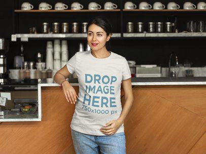 T-Shirt Mockup of a Pregnant Woman at a Coffee Shop a7962