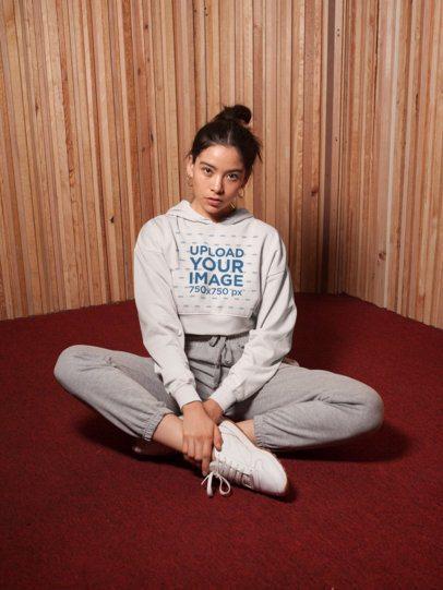 Crop Top Hoodie Mockup of a Cute Girl Sitting on the Floor of a Vintage-Looking Room 26100