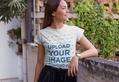 Mockup of a Chic Woman Wearing a T-Shirt and Smiling 26350