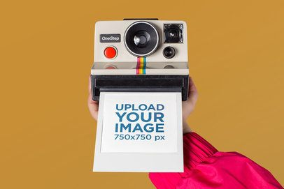 Polaroid Picture Frame Mockup Featuring an Arm Holding a Retro Camera 26160