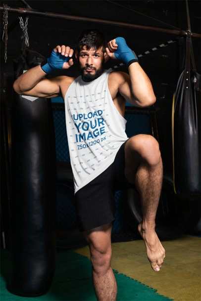 Tank Top Mockup of an MMA Wrestler on a Fighting Pose Inside an Octagon 26247