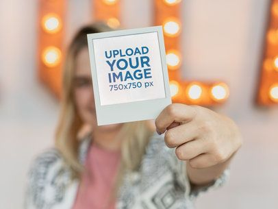 Polaroid Frame Mockup of a Woman Holding Up Her Polaroid Picture 26305