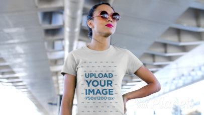 T-Shirt Video of a Rebel Girl Chewing Gum Under a Bridge 12829
