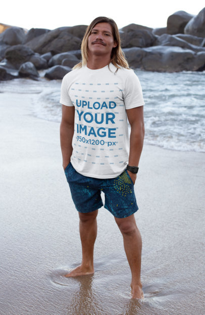T-Shirt Mockup of a Blonde Long-Haired Man Barefoot at the Beach 26835