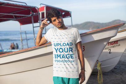 T-Shirt Mockup of a Man Leaning on a Panga Boat 26754