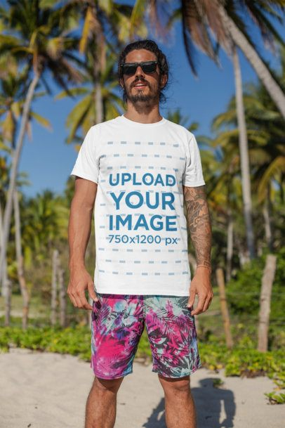 T-Shirt Mockup of a Man with Surfer Shorts Standing at the Beach 26755
