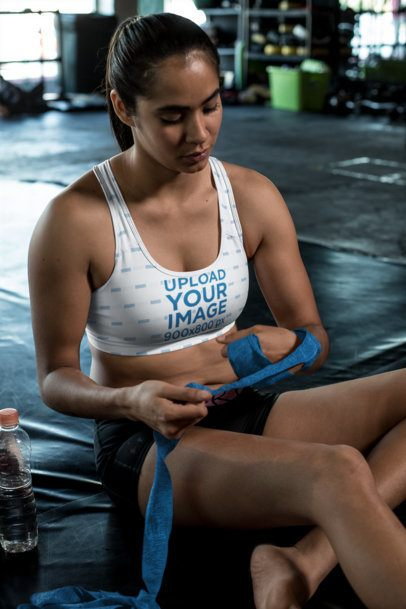 Sports Bra Mockup of an MMA Athlete Wrapping Her Hands 26267