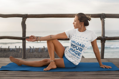 T-Shirt Mockup of a Woman Doing Yoga by the Sea 26854
