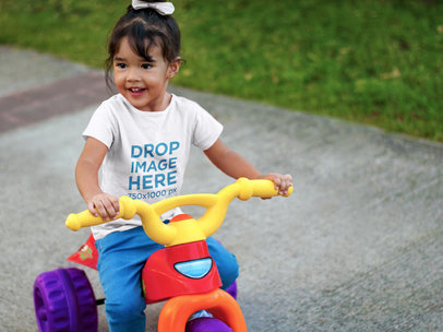Little Girl Riding a Bicycle T-Shirt Mockup a7676