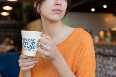 Coffee Mug Mockup of a Pensive Woman with Finger Tattoos 26448