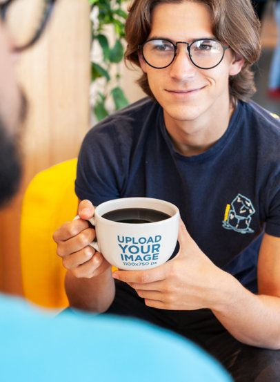 Over-The-Shoulder Mockup of a Young Man with Glasses Holding a Coffee Mug 26510