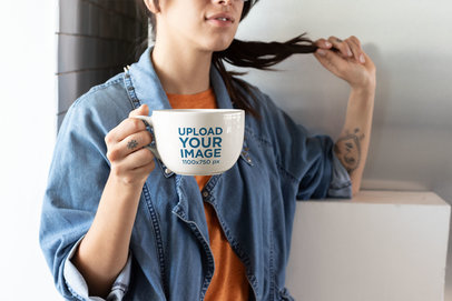 Coffee Mug Mockup of a Tattooed Girl in a Denim Jacket Twisting Her Hair 26457