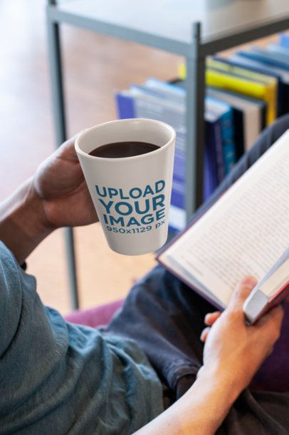 11 Oz Coffee Mug Mockup of a Man Reading a Book 26517
