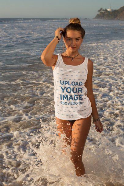 Tank Top Mockup of a Young Woman Posing by Crashing Waves at the Beach 26785