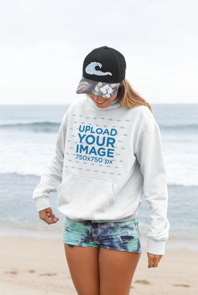 Pullover Hoodie Mockup of a Smiling Woman Against Beach Waves 26819