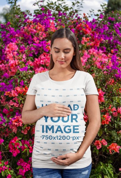 Tee Mockup of a Pregnant Woman Against a Blooming Flower Bush 26656
