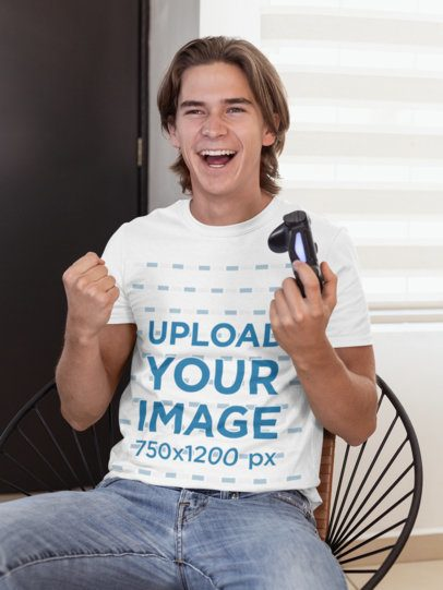 T-Shirt Mockup of a Cheerful Gamer Man Holding a Play Station Controller 26894