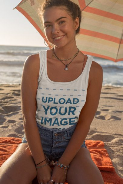 Tank Top Mockup of a Smiling Woman Sitting Under a Beach Parasol 26780