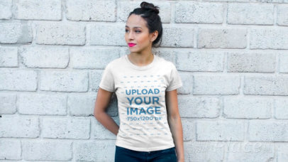 T-Shirt Video Featuring a Young Woman Posing Against a Gray Brick Wall 12828