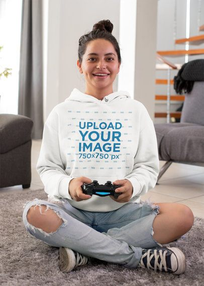Mockup of a Gamer Woman Wearing a Hoodie While Playing Video Games 26912