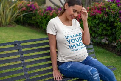 T-Shirt Mockup of a Happy Pregnant Woman Sitting at a Garden 26661
