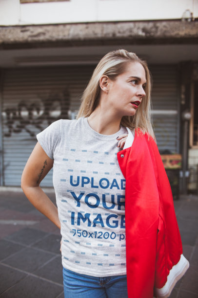 T-Shirt Mockup of a Lady in a Red Jacket at a Closed Market Place 23950
